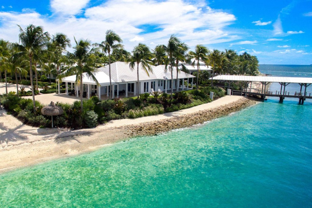 aerial view of cottage right on the beach of an island in the Florida Keys