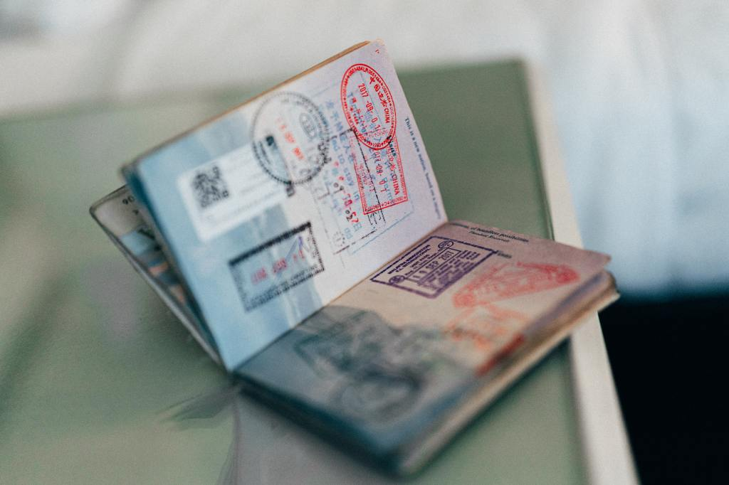 passport showing customs stamps for visas and entering and exiting countries