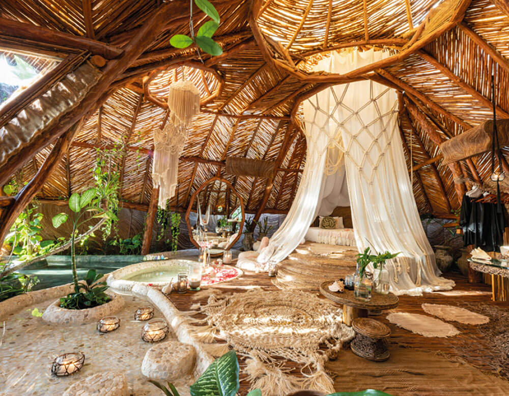 hotel domed-room made up of wood with accents of stone, including a pool, bed, and furniture