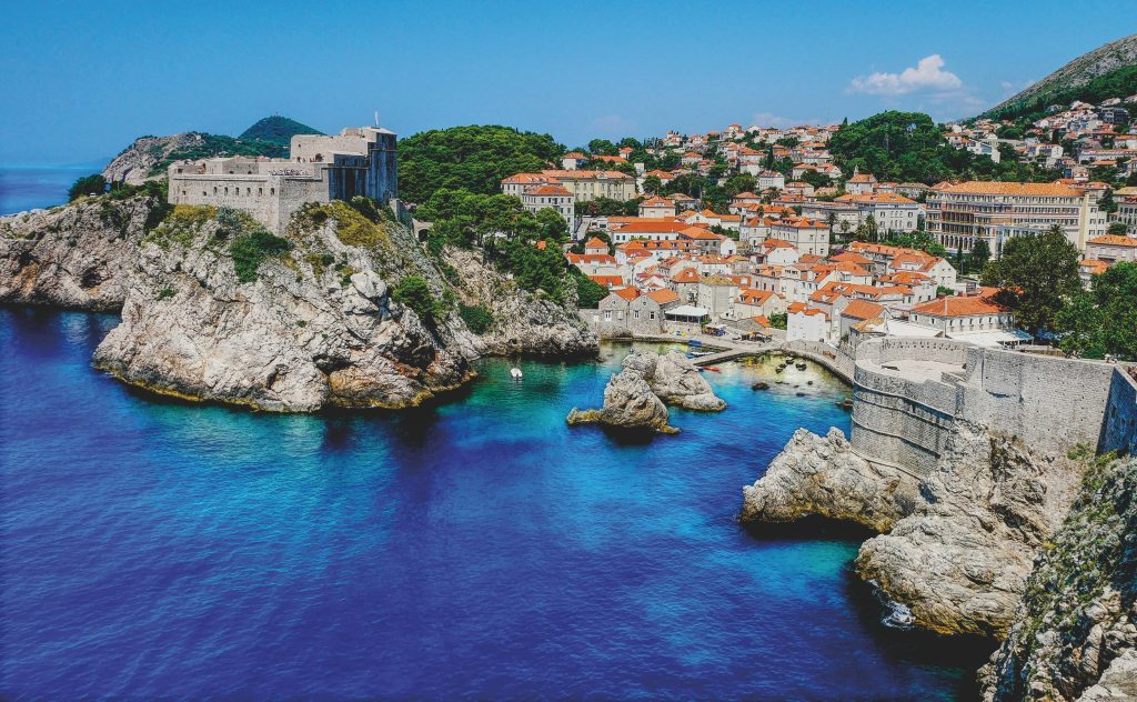 The Pearl of the Adriatic known as Dubrovnik with its special clear blue color waters along the medieval stone ramparts of the old city built into the natural rocky landscape